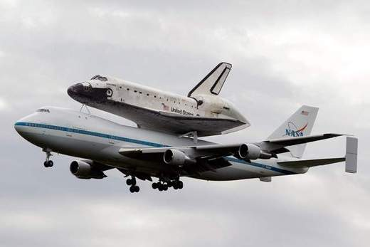 Space Shuttle Discovery Hitches A Ride To Washington D.C.